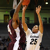"Spencer Dinwiddie of Colorado shoots over Fred Sturdivant of Texas Southern during the first half of the December 22, 2011 game in Boulder.<br /> <br /> For more photos of the game, go to  <a href=""http://www.dailycamera.com"">http://www.dailycamera.com</a>.<br /> December 22, 2011 / Cliff Grassmick"