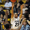 "Spencer Dinwiddie of Colorado a Texas Souther defender<br /> during the second half of the December 22, 2011 game in Boulder.<br /> <br /> For more photos of the game, go to  <a href=""http://www.dailycamera.com"">http://www.dailycamera.com</a>.<br /> December 22, 2011 / Cliff Grassmick"