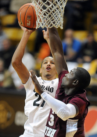 "Andre Roberson of Colorado shoots over Daniel King of Texas Southern during the second half of the December 22, 2011 game in Boulder.<br /> <br /> For more photos of the game, go to  <a href=""http://www.dailycamera.com"">http://www.dailycamera.com</a>.<br /> December 22, 2011 / Cliff Grassmick"