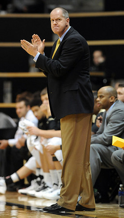 "Colorado coach, Tad Boyle, encourages his team against Texas Southern during the first half of the December 22, 2011 game in Boulder.<br /> <br /> For more photos of the game, go to  <a href=""http://www.dailycamera.com"">http://www.dailycamera.com</a>.<br /> December 22, 2011 / Cliff Grassmick"