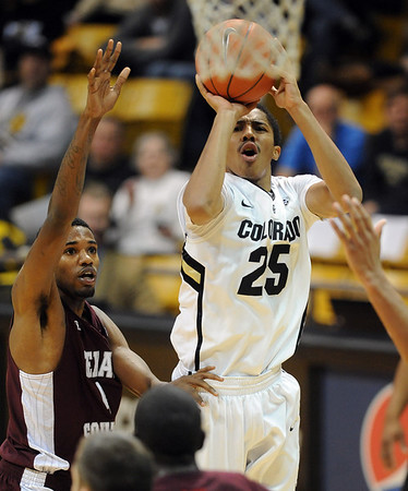 "Spencer Dinwiddie of Colorado shoots over Fred Sturdivant of  Texas Southern during the second half of the December 22, 2011 game in Boulder.<br /> For more photos of the game, go to  <a href=""http://www.dailycamera.com"">http://www.dailycamera.com</a>.<br /> December 22, 2011 / Cliff Grassmick"