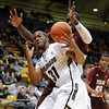 "Jeremy Adams of Colorado tries to control a rebound in front of Daniel King of Texas Southern during the first half of the December 22, 2011 game in Boulder.<br /> <br /> For more photos of the game, go to  <a href=""http://www.dailycamera.com"">http://www.dailycamera.com</a>.<br /> December 22, 2011 / Cliff Grassmick"