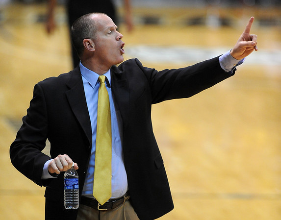 """Tad Boyle works the Texas Southern game <br /> during the second half of the December 22, 2011 game in Boulder.<br /> <br /> For more photos of the game, go to  <a href=""""http://www.dailycamera.com"""">http://www.dailycamera.com</a>.<br /> December 22, 2011 / Cliff Grassmick"""