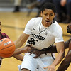"Spencer Dinwiddie of Colorado, drives between Madarious Gibbs left, and Omar Strong both  of Texas Southern during the second half of the December 22, 2011 game in Boulder.<br /> <br /> For more photos of the game, go to  <a href=""http://www.dailycamera.com"">http://www.dailycamera.com</a>.<br /> December 22, 2011 / Cliff Grassmick"