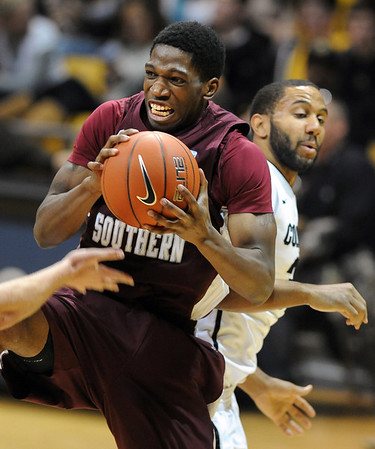 """Patrick Onwenu of Texas Southern, gets a rebound in front of Carlon Brown of Colorado during the second half of the December 22, 2011 game in Boulder.<br /> <br /> For more photos of the game, go to  <a href=""""http://www.dailycamera.com"""">http://www.dailycamera.com</a>.<br /> December 22, 2011 / Cliff Grassmick"""
