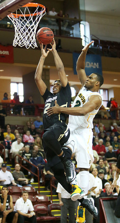 Colorado's Xavier Johnson, left, drives to the basket past Baylor's Rico Gathers during the second half of an NCAA college basketball game at the Charleston ClassicFriday Nov. 16, 2012,  at TD Arena in Charleston, S.C. Colorado won 60-58. (AP Photo/Alice Keeney)