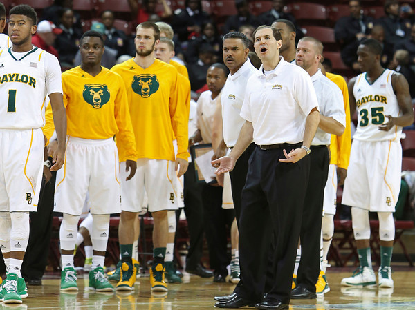 Baylor head basketball coach, Scott Drew, right, yells at an official during the second half of an NCAA college basketball game against Colorado at the Charleston Classic at TD Arena, Friday Nov. 16, 2012, in Charleston, S.C.  Colorado won 60-58. (AP Photo/Alice Keeney)