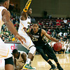 Colorado's Spencer Dinwiddie, right dribbles past Baylor's Cory Jefferson, left, during the second half of an NCAA college basketball game at the Charleston Classic at TD Arena, Friday, Nov. 16, 2012, in Charleston, S.C. Colorado won 60-58. (AP Photo/Alice Keeney)