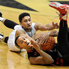 "Brandon Taylor of Utah tries to call a timeout before Askia Booker of Colorado can get to the ball during the second half of the February 21st, 2013 game in Boulder.<br /> For more photos of the game, go to  <a href=""http://www.dailycamera.com"">http://www.dailycamera.com</a>.<br /> Cliff Grassmick / February 21, 2013"