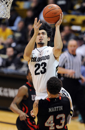 """Sabatino Chen of Colorado drives to the basket into Cedric Martin of Utah during the second half of the February 21st, 2013 game in Boulder.<br /> For more photos of the game, go to  <a href=""""http://www.dailycamera.com"""">http://www.dailycamera.com</a>.<br /> Cliff Grassmick / February 21, 2013"""