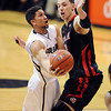 "Askia Booker of CU shoots around Jason Washburn of Utah during the second half of the February 21st, 2013 game in Boulder.<br /> For more photos of the game, go to  <a href=""http://www.dailycamera.com"">http://www.dailycamera.com</a>.<br /> Cliff Grassmick / February 21, 2013"