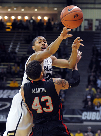 "Spencer Dinwiddie of Colorado gets a pass over Cedric Martin of Utah during the first half of the February 21st, 2013 game in Boulder.<br /> For more photos of the game, go to  <a href=""http://www.dailycamera.com"">http://www.dailycamera.com</a>.<br /> Cliff Grassmick / February 21, 2013"