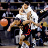 "An inbounds pass gets over Askia Booker, top, of Colorado, and Brandon Taylor of Utah during the first half of the February 21st, 2013 game in Boulder.<br /> For more photos of the game, go to  <a href=""http://www.dailycamera.com"">http://www.dailycamera.com</a>.<br /> Cliff Grassmick / February 21, 2013"