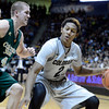 "University of Colorado's Xavier Johnson drives to the hoop past Pierce Hornung during a game against Colorado State University on Wednesday, Dec. 5, at the Coors Event Center on the CU campus in Boulder. For more photos of the game go to  <a href=""http://www.dailycamera.com"">http://www.dailycamera.com</a><br /> Jeremy Papasso/ Camera"