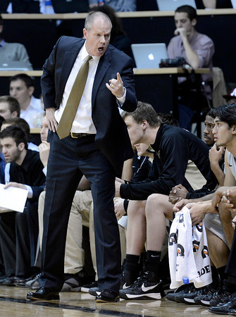 """University of Colorado Head Coach Tad Boyle yells to players sitting on the bench during a game against Colorado State University on Wednesday, Dec. 5, at the Coors Event Center on the CU campus in Boulder. CU won 70-61. For more photos of the game go to  <a href=""""http://www.dailycamera.com"""">http://www.dailycamera.com</a><br /> Jeremy Papasso/ Camera"""