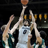 "University of Colorado's Askia Booker takes a shot over Pierce Hornung, left, and Dorian Green during a game against Colorado State University on Wednesday, Dec. 5, at the Coors Event Center on the CU campus in Boulder. For more photos of the game go to  <a href=""http://www.dailycamera.com"">http://www.dailycamera.com</a><br /> Jeremy Papasso/ Camera"