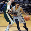 "Spencer  Dinwiddie of CU drives past Wes Eikmeier of CSU in the second half.<br /> For more photos from CU CSU basketball, go to  <a href=""http://www.dailycamera.com"">http://www.dailycamera.com</a>.<br /> Cliff Grassmick / December 5, 2012"