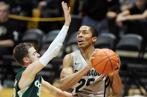 """Spencer  Dinwiddie of CU drives past Wes Eikmeier of CSU in the second half.<br /> For more photos from CU CSU basketball, go to  <a href=""""http://www.dailycamera.com"""">http://www.dailycamera.com</a>.<br /> Cliff Grassmick / December 5, 2012"""