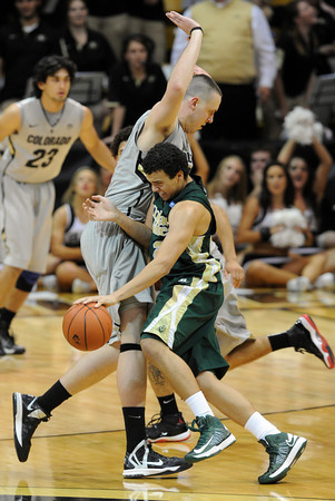 """Dorian Green of CSU hits the wall of Shane Harris-Tunks of CU.<br /> For more photos from CU CSU basketball, go to  <a href=""""http://www.dailycamera.com"""">http://www.dailycamera.com</a>.<br /> Cliff Grassmick / December 5, 2012"""