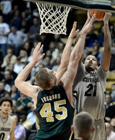 """University of Colorado's Andre Roberson takes a shot over Colton Iverson during a game against Colorado State University on Wednesday, Dec. 5, at the Coors Event Center on the CU campus in Boulder. CU won 70-61. For more photos of the game go to  <a href=""""http://www.dailycamera.com"""">http://www.dailycamera.com</a><br /> Jeremy Papasso/ Camera"""