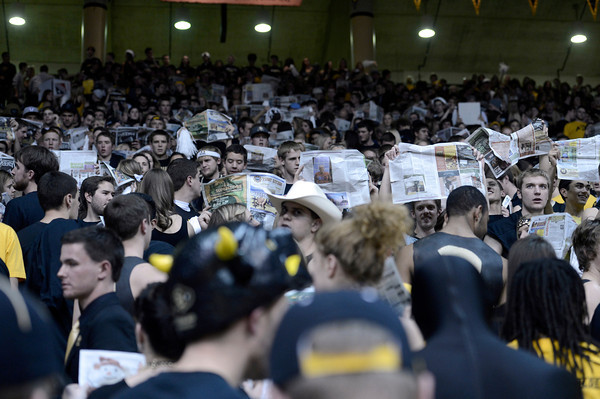 "University of Colorado student fans turn their back and pretend to read the newspaper while CSU announces their starting lineup at the start of the game against Colorado State University on Wednesday, Dec. 5, at the Coors Event Center on the CU campus in Boulder. CU won 70-61. For more photos of the game go to  <a href=""http://www.dailycamera.com"">http://www.dailycamera.com</a><br /> Jeremy Papasso/ Camera"