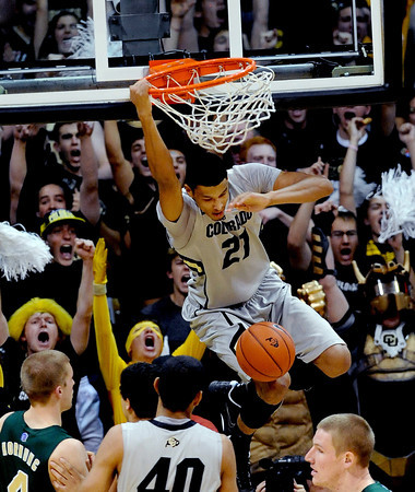 "Andre Roberson of CU  gets a break away slam in the CSU game.<br /> For more photos from CU CSU basketball, go to  <a href=""http://www.dailycamera.com"">http://www.dailycamera.com</a>.<br /> Cliff Grassmick / December 5, 2012"