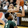 "Spencer  Dinwiddie of CU drives past Jon Octeus of CSU in the second half.<br /> For more photos from CU CSU basketball, go to  <a href=""http://www.dailycamera.com"">http://www.dailycamera.com</a>.<br /> Cliff Grassmick / December 5, 2012"