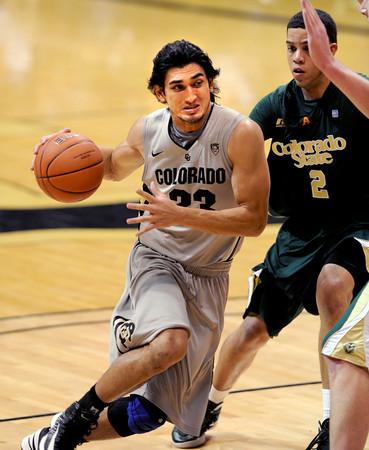 "Sabatino Chen drives to the basket past Daniel Bejarano of CSU.<br /> For more photos from CU CSU basketball, go to  <a href=""http://www.dailycamera.com"">http://www.dailycamera.com</a>.<br /> Cliff Grassmick / December 5, 2012"