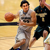 "Sabatino Chen drives to the basket past Daniel Bejarano of CSU.<br /> For more photos from CU CSU basketball, go to  <a href=""http://www.dailycamera.com"">http://www.dailycamera.com</a>.<br /> Cliff Grassmick / December 5, 2012"