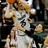 "Spencer Dinwiddie of CU gets the pass away before the foul of Daniel Bejarano of CSU.<br /> For more photos from CU CSU basketball, go to  <a href=""http://www.dailycamera.com"">http://www.dailycamera.com</a>.<br /> Cliff Grassmick / December 5, 2012"