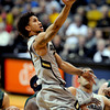 "Askia Booker of CU drives to the basket late in the game against CSU.<br /> For more photos from CU CSU basketball, go to  <a href=""http://www.dailycamera.com"">http://www.dailycamera.com</a>.<br /> Cliff Grassmick / December 5, 2012"