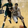 "University of Colorado's Spencer Dinwiddie drives past Jon Octeus during a game against Colorado State University on Wednesday, Dec. 5, at the Coors Event Center on the CU campus in Boulder. For more photos of the game go to  <a href=""http://www.dailycamera.com"">http://www.dailycamera.com</a><br /> Jeremy Papasso/ Camera"
