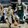 "University of Colorado's Askia Booker dribbles past Colton Iverson during a game against Colorado State University on Wednesday, Dec. 5, at the Coors Event Center on the CU campus in Boulder. CU won 70-61. For more photos of the game go to  <a href=""http://www.dailycamera.com"">http://www.dailycamera.com</a><br /> Jeremy Papasso/ Camera"