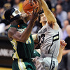 "Sabatino Chen of CU blocks the shot of Greg Smith of CSU.<br /> For more photos from CU CSU basketball, go to  <a href=""http://www.dailycamera.com"">http://www.dailycamera.com</a>.<br /> Cliff Grassmick / December 5, 2012"