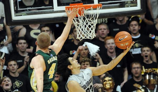 """Sabatino Chen of CU scores on Pierce Hornung of CSU. of CSU.<br /> For more photos from CU CSU basketball, go to  <a href=""""http://www.dailycamera.com"""">http://www.dailycamera.com</a>.<br /> Cliff Grassmick / December 5, 2012"""