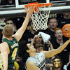 "Sabatino Chen of CU scores on Pierce Hornung of CSU. of CSU.<br /> For more photos from CU CSU basketball, go to  <a href=""http://www.dailycamera.com"">http://www.dailycamera.com</a>.<br /> Cliff Grassmick / December 5, 2012"