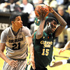"Gerson Santo of CSU gets the rebound in front of Andre Roberson.<br /> For more photos from CU CSU basketball, go to  <a href=""http://www.dailycamera.com"">http://www.dailycamera.com</a>.<br /> Cliff Grassmick / December 5, 2012"
