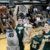 "University of Colorado's Josh Scott takes a shot over Pierce Hornung, No. 4, and Dorian Green, No. 22, during a game against Colorado State University on Wednesday, Dec. 5, at the Coors Event Center on the CU campus in Boulder. For more photos of the game go to  <a href=""http://www.dailycamera.com"">http://www.dailycamera.com</a><br /> Jeremy Papasso/ Camera"