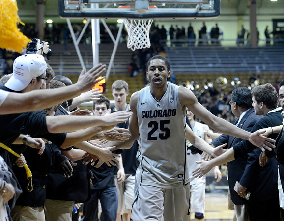 "University of Colorado's Spencer Dinwiddie high- fives fans after defeating CSU 70-61 during a game on Wednesday, Dec. 5, at the Coors Event Center on the CU campus in Boulder. For more photos of the game go to  <a href=""http://www.dailycamera.com"">http://www.dailycamera.com</a><br /> Jeremy Papasso/ Camera"
