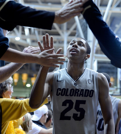 """University of Colorado's Spencer Dinwiddie high-fives fans after defeating Colorado State University 70-61 during a game on Wednesday, Dec. 5, at the Coors Event Center on the CU campus in Boulder. For more photos of the game go to  <a href=""""http://www.dailycamera.com"""">http://www.dailycamera.com</a><br /> Jeremy Papasso/ Camera"""