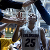 "University of Colorado's Spencer Dinwiddie high-fives fans after defeating Colorado State University 70-61 during a game on Wednesday, Dec. 5, at the Coors Event Center on the CU campus in Boulder. For more photos of the game go to  <a href=""http://www.dailycamera.com"">http://www.dailycamera.com</a><br /> Jeremy Papasso/ Camera"