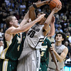 "University of Colorado's Josh Scott goes for a shot over Pierce Hornung during a game against Colorado State University on Wednesday, Dec. 5, at the Coors Event Center on the CU campus in Boulder. CU won 70-61. For more photos of the game go to  <a href=""http://www.dailycamera.com"">http://www.dailycamera.com</a><br /> Jeremy Papasso/ Camera"