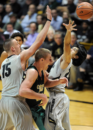 """Coloton Iverson of CSU is trapped by Shane Harris-Tunks and Sabatino Chen of CU.<br /> For more photos from CU CSU basketball, go to  <a href=""""http://www.dailycamera.com"""">http://www.dailycamera.com</a>.<br /> Cliff Grassmick / December 5, 2012"""