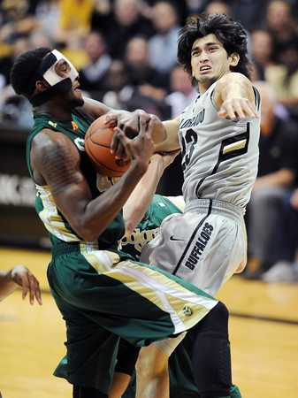 """Sabatino Chen of CU tries to block the shot of Greg Smith of CSU.<br /> For more photos from CU CSU basketball, go to  <a href=""""http://www.dailycamera.com"""">http://www.dailycamera.com</a>.<br /> Cliff Grassmick / December 5, 2012"""