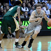 "University of Colorado's Eli Stalzer drives past Jon Octeus during a game against Colorado State University on Wednesday, Dec. 5, at the Coors Event Center on the CU campus in Boulder. CU won 70-61. For more photos of the game go to  <a href=""http://www.dailycamera.com"">http://www.dailycamera.com</a><br /> Jeremy Papasso/ Camera"