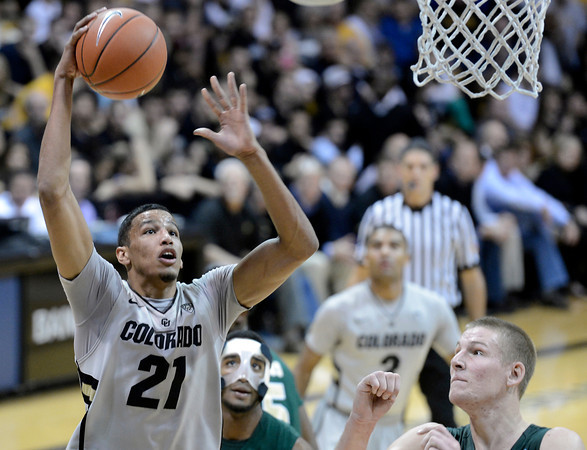 """University of Colorado's Andre Roberson drives to the hoop over Gerson Santo during a game against Colorado State University on Wednesday, Dec. 5, at the Coors Event Center on the CU campus in Boulder. For more photos of the game go to  <a href=""""http://www.dailycamera.com"""">http://www.dailycamera.com</a><br /> Jeremy Papasso/ Camera"""