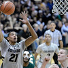 "University of Colorado's Andre Roberson drives to the hoop over Gerson Santo during a game against Colorado State University on Wednesday, Dec. 5, at the Coors Event Center on the CU campus in Boulder. For more photos of the game go to  <a href=""http://www.dailycamera.com"">http://www.dailycamera.com</a><br /> Jeremy Papasso/ Camera"