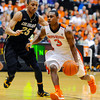 Oregon State's Ahmad Starks (3) drives against Colorado's Spencer Dinwiddie (25) during the second half of an NCAA college basketball game in Corvallis, Ore., Sunday, Feb. 10, 2013. Colorado won 72-68. (AP Photo/Greg Wahl-Stephens)