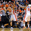 Oregon State's Devon Collier (44) and Eric Moreland defend against Colorado's Askia Booker (0) during the second half of an NCAA college basketball game in Corvallis, Ore., Sunday, Feb. 10, 2013. Colorado won 72-68. (AP Photo/Greg Wahl-Stephens)