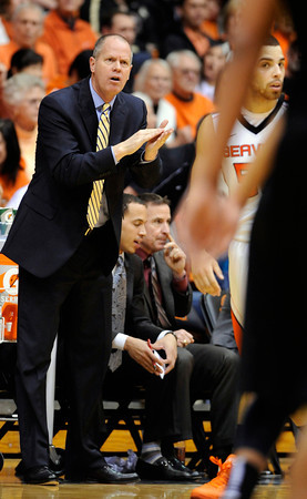 Colorado head coach Tad Boyle makes a call during the second half of an NCAA college basketball game against Oregon State in Corvallis, Ore., Sunday, Feb. 10, 2013. Colorado won 72-68. (AP Photo/Greg Wahl-Stephens)
